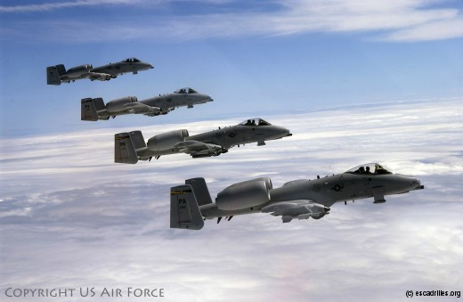 Four A-10s from the 111th Fighter Wing (FW), Willow Grove Air Reserve Station, PA fly in formation after taking on fuel from a KC-10A Extender from the 514th Air Mobility Wing, McGuire Air Force Base, NJ. The A-10s were on a training mission that included the air refueling. This image was taken on May 25, 2005. USAF photo by Kenn Mann.