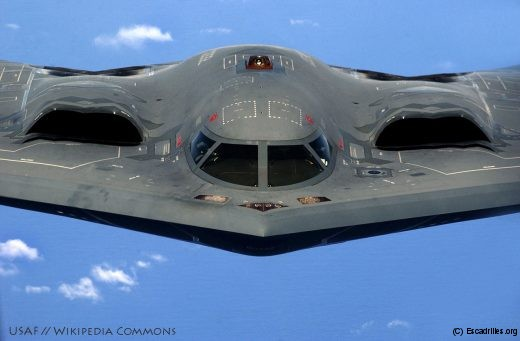 "A U.S. Air Force B-2 Spirit ""Stealth"" bomber, 393rd Expeditionary Bomb Squadron, 509th Bomb Wing, Whiteman Air Force Base, Mo., flies over the Pacific Ocean after a recent aerial refueling mission, May 2, 2005. The Bombers are deployed to Anderson Air Force Base, Guam, as part of a rotation that has provided the U.S. Pacific Command a continous bomber presence in the Asian Pacific region since February 2004, enhancing regional security and the U.S. commitment to the Western Pacific. (U.S. Air Force photo by Tech Sgt. Cecilio Ricardo) (Released)"